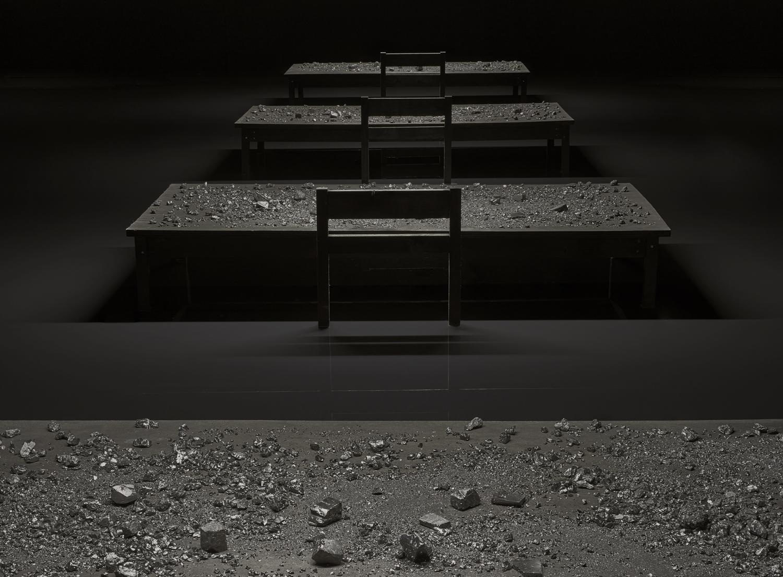 Installation, 11m x 10m, 8 desks, pigmented water, coal, 2016